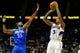 Nov 26, 2013; Atlanta, GA, USA; Atlanta Hawks shooting guard Louis Williams (3) shoots a basket over Orlando Magic point guard E'Twaun Moore (55) in the second half at Philips Arena. The Magic won 109-92. Mandatory Credit: Daniel Shirey-USA TODAY Sports
