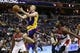 Nov 26, 2013; Washington, DC, USA; Los Angeles Lakers point guard Steve Blake (5) shoots the ball as Washington Wizards point guard John Wall (2) looks on in the third quarter at Verizon Center. The Wizards won 116-111. Mandatory Credit: Geoff Burke-USA TODAY Sports