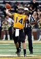 Nov 16, 2013; Hattiesburg, MS, USA; Southern Mississippi Golden Eagles quarterback Nick Mullens (14) throws a pass against the Florida Atlantic Owls during the first half at M.M. Roberts Stadium. Mandatory Credit: Chuck Cook-USA TODAY Sports