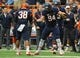 Nov 23, 2013; Syracuse, NY, USA; Syracuse Orange defensive end Robert Welsh (94) and linebacker Cameron Lynch (38) celebrate a defensive stop against the Pittsburgh Panthers during the first quarterat the Carrier Dome.  Pittsburgh defeated Syracuse 17-16.  Mandatory Credit: Rich Barnes-USA TODAY Sports