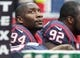 Nov 24, 2013; Houston, TX, USA; Houston Texans defensive end Antonio Smith (94) sits on the bench during the first quarter against the Jacksonville Jaguars at Reliant Stadium. Mandatory Credit: Troy Taormina-USA TODAY Sports