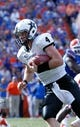 Nov 9, 2013; Gainesville, FL, USA; Vanderbilt Commodores quarterback Patton Robinette (4) runs with the ball during the second half against the Florida Gators at Ben Hill Griffin Stadium. Vanderbilt Commodores defeated the Florida Gators 34-17. Mandatory Credit: Kim Klement-USA TODAY Sports