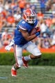 Nov 9, 2013; Gainesville, FL, USA; Florida Gators wide receiver Trey Burton (8) runs with the ball against the Vanderbilt Commodores during the second half at Ben Hill Griffin Stadium. Vanderbilt Commodores defeated the Florida Gators 34-17. Mandatory Credit: Kim Klement-USA TODAY Sports