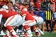 Nov 24, 2013; Kansas City, MO, USA; Kansas City Chiefs quarterback Alex Smith (11) goes under center during the first half of the game against the San Diego Chargers at Arrowhead Stadium. The Chargers won 41-38. Mandatory Credit: Denny Medley-USA TODAY Sports