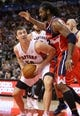 Nov 22, 2013; Toronto, Ontario, CAN; Toronto Raptors forward Tyler Hansbrough (50) is guarded by Washington Wizards forward Nene (42) at Air Canada Centre. The Raptors beat the Wizards 96-88. Mandatory Credit: Tom Szczerbowski-USA TODAY Sports