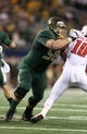 Nov 16, 2013; Arlington, TX, USA; Baylor Bears tackle Spencer Drango (58) in action against the Texas Tech Red Raiders at AT&T Stadium. Mandatory Credit: Matthew Emmons-USA TODAY Sports