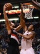 Nov 27, 2013; Phoenix, AZ, USA; Portland Trail Blazers center Robin Lopez (42) goes up with the ball against the Phoenix Suns forward Channing Frye (8) in the first half at US Airways Center. Mandatory Credit: Jennifer Stewart-USA TODAY Sports