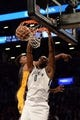 Nov 27, 2013; Brooklyn, NY, USA; Brooklyn Nets center Andray Blatche (0) dunks against the Los Angeles Lakers during the second half at Barclays Center. The Lakers won 99-94. Mandatory Credit: Joe Camporeale-USA TODAY Sports l