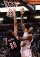 Nov 27, 2013; Phoenix, AZ, USA; Phoenix Suns forward Channing Frye (8) shoots the ball against the Portland Trail Blazers forward Nicolas Batum (88) in the second half at US Airways Center. The Suns won 120-106. Mandatory Credit: Jennifer Stewart-USA TODAY Sports