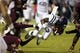 Nov 28, 2013; Starkville, MS, USA; Mississippi Rebels running back Jaylen Walton (6) advances the ball and is tripped up by Mississippi State Bulldogs defensive back Will Redmond (2) during the game at Davis Wade Stadium. Mandatory Credit: Spruce Derden-USA TODAY Sports