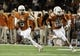 Nov 28, 2013; Austin, TX, USA; Texas Longhorns quarterback Case McCoy (6) scrambles with help from tight end Geoff Swain (82) against the Texas Tech Red Raiders during the first quarter at Darrell K Royal-Texas Memorial Stadium. Mandatory Credit: Brendan Maloney-USA TODAY Sports