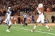 Nov 28, 2013; Austin, TX, USA; Texas Longhorns wide receiver Mike Davis (1) catches a pass ahead of Texas Tech Red Raiders defensive back Justis Nelson (31) during the first quarter at Darrell K Royal-Texas Memorial Stadium. Mandatory Credit: Brendan Maloney-USA TODAY Sports