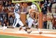Nov 28, 2013; Austin, TX, USA; Texas Longhorns wide receiver Mike Davis (1) scores a touchdown ahead of Texas Tech Red Raiders defensive back Justis Nelson (31) during the first quarter at Darrell K Royal-Texas Memorial Stadium. Mandatory Credit: Brendan Maloney-USA TODAY Sports