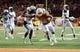 Nov 28, 2013; Austin, TX, USA; Texas Longhorns tailback Joe Bergeron (32), scores a touchdown ahead of Texas Tech Red Raiders linebacker Will Smith (7) during the second quarter at Darrell K Royal-Texas Memorial Stadium. Mandatory Credit: Brendan Maloney-USA TODAY Sports