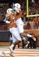 Nov 28, 2013; Austin, TX, USA; Texas Longhorns wide receiver Mike Davis (1) and tight end Miles Onyegbule (17) react after a touchdown against the Texas Tech Red Raiders during the first quarter at Darrell K Royal-Texas Memorial Stadium. Mandatory Credit: Brendan Maloney-USA TODAY Sports