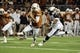 Nov 28, 2013; Austin, TX, USA; Texas Longhorns quarterback Case McCoy (6) carries the ball ahead of Texas Tech Red Raiders linebacker Pete Robinson (10) during the second half at Darrell K Royal-Texas Memorial Stadium. Texas beat Texas Tech 41-16. Mandatory Credit: Brendan Maloney-USA TODAY Sports