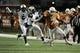 Nov 28, 2013; Austin, TX, USA; Texas Longhorns wide receiver Marcus Johnson (7) carries the ball against Texas Tech Red Raiders defensive backs Olaoluwa Falemi (29) and Tre' Porter (5) during the second half at Darrell K Royal-Texas Memorial Stadium. Texas beat Texas Tech 41-16. Mandatory Credit: Brendan Maloney-USA TODAY Sports