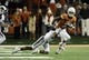 Nov 28, 2013; Austin, TX, USA; Texas Longhorns wide receiver Marcus Johnson (7) carries the ball against Texas Tech Red Raiders defensive back Justis Nelson (31) during the second half at Darrell K Royal-Texas Memorial Stadium. Texas beat Texas Tech 41-16. Mandatory Credit: Brendan Maloney-USA TODAY Sports