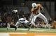Nov 28, 2013; Austin, TX, USA; Texas Longhorns quarterback Tyrone Swoopes (18) runs the ball against Texas Tech Red Raiders defensive back Tre' Porter (5)during the second half at Darrell K Royal-Texas Memorial Stadium. Texas beat Texas Tech 41-16. Mandatory Credit: Brendan Maloney-USA TODAY Sports