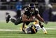 Nov 28, 2013; Baltimore, MD, USA; Baltimore Ravens wide receiver Torrey Smith (82) gets tackled by Pittsburgh Steelers cornerback Ike Taylor (24) during a NFL football game on Thanksgiving at M&T Bank Stadium. Mandatory Credit: Evan Habeeb-USA TODAY Sports