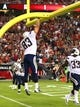 Aug. 24, 2013; Glendale, AZ, USA: San Diego Chargers tight end John Phillips dunks the ball over the goal post as he celebrates a touchdown against the Arizona Cardinals during a preseason game at University of Phoenix Stadium. Mandatory Credit: Mark J. Rebilas-USA TODAY Sports