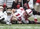 Nov 29, 2013; Houston, TX, USA; Southern Methodist Mustangs quarterback Neal Burcham (12) lies on the ground after a play during the first quarter against the Houston Cougars at Reliant Stadium. Mandatory Credit: Troy Taormina-USA TODAY Sports