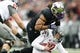 Nov 29, 2013; Seattle, WA, USA; Washington Huskies defensive end Hau'oli Kikaha (8) sacks Washington State Cougars quarterback Connor Hlliday (12) during the second quarter at Husky Stadium. Mandatory Credit: Joe Nicholson-USA TODAY Sports