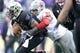 Nov 29, 2013; Seattle, WA, USA; Washington Huskies quarterback Keith Price (17) is tackled by Washington State Cougars defensive end Xavier Cooper (96) during the second half at Husky Stadium. Mandatory Credit: Joe Nicholson-USA TODAY Sports