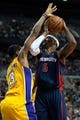 Nov 29, 2013; Auburn Hills, MI, USA; Los Angeles Lakers power forward Shawne Williams (3) guards Detroit Pistons small forward Josh Smith (6) during the fourth quarter at The Palace of Auburn Hills. Lakers won 106-102. Mandatory Credit: Tim Fuller-USA TODAY Sports