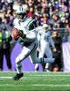 Nov 24, 2013; Baltimore, MD, USA; New York Jets quarterback Geno Smith (7) looks to pass the ball during the game against the Baltimore Ravens at M&T Bank Stadium. Mandatory Credit: Evan Habeeb-USA TODAY Sports