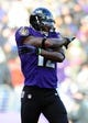Nov 24, 2013; Baltimore, MD, USA; Baltimore Ravens wide receiver Jacoby Jones (12) reacts after returning a punt during the game against the New York Jets at M&T Bank Stadium. Mandatory Credit: Evan Habeeb-USA TODAY Sports