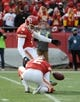 Nov 24, 2013; Kansas City, MO, USA; Kansas City Chiefs kicker Ryan Succop (6) kicks an extra point with the help of punter Dustin Colquitt (2) against the San Diego Chargers in the first half at Arrowhead Stadium. San Diego won 41-38. Mandatory Credit: John Rieger-USA TODAY Sports