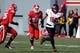 Nov 30, 2013; Raleigh, NC, USA; Maryland Terrapins quarterback C.J. Brown (16) runs the ball as North Carolina State Wolfpack defenders Brandon Pittman (39) and Dontae Johnson (25) pursue during the first half at Carter Finley Stadium. Mandatory Credit: Rob Kinnan-USA TODAY Sports