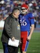 Nov 30, 2013; Lawrence, KS, USA; Kansas Jayhawks head coach Charlie Weis talks to punter Trevor Pardula (16) against the Kansas State Wildcats in the first half at Memorial Stadium. Mandatory Credit: John Rieger-USA TODAY Sports