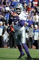 Nov 30, 2013; Lawrence, KS, USA; Kansas State Wildcats defensive back Dante Barnett (22) intercepts a pass against the Kansas Jayhawks in the second half at Memorial Stadium. Kansas State won the game 31-10. Mandatory Credit: John Rieger-USA TODAY Sports