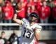 Nov 30, 2013; Salt Lake City, UT, USA; Colorado Buffaloes quarterback Sefo Liufau (13) passes the ball during the second half against the Utah Utes at Rice-Eccles Stadium. Utah won 24-17. Mandatory Credit: Russ Isabella-USA TODAY Sports