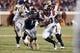 Nov 30, 2013; Charlottesville, VA, USA; Virginia Tech Hokies running back Trey Edmunds (14) runs with the ball as Virginia Cavaliers linebacker Daquan Romero (13) defends in the fourth quarter at Scott Stadium. The Hokies won 16-6. Mandatory Credit: Geoff Burke-USA TODAY Sports