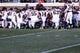 Nov 30, 2013; Charlottesville, VA, USA; Virginia Tech Hokies players kneel on the field prior to their game against the Virginia Cavaliers at Scott Stadium. The Hokies won 16-6. Mandatory Credit: Geoff Burke-USA TODAY Sports