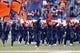 Nov 30, 2013; Charlottesville, VA, USA; Virginia Cavaliers cheerleaders run onto the field prior to their game against the Virginia Tech Hokies at Scott Stadium. The Hokies won 16-6. Mandatory Credit: Geoff Burke-USA TODAY Sports