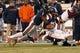 Nov 30, 2013; Charlottesville, VA, USA; Virginia Tech Hokies quarterback Logan Thomas (3) runs with the ball as Virginia Cavaliers defensive end Eli Harold (7) makes the tackle in the third quarter at Scott Stadium. The Hokies won 16-6. Mandatory Credit: Geoff Burke-USA TODAY Sports