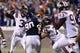 Nov 30, 2013; Charlottesville, VA, USA; Virginia Tech Hokies quarterback Logan Thomas (3) throws the ball as Virginia Cavaliers defensive end Jake Snyder (90) defends in the third quarter at Scott Stadium. The Hokies won 16-6. Mandatory Credit: Geoff Burke-USA TODAY Sports