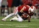Nov 30, 2013; Madison, WI, USA; Wisconsin Badgers wide receiver Jared Abbrederis (4) hauls in a pass as his team plays the Wisconsin Badgers at Camp Randall Stadium. Penn State defeated Wisconsin 31-24. Mandatory Credit: Mary Langenfeld-USA TODAY Sports