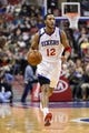Nov 29, 2013; Philadelphia, PA, USA; Philadelphia 76ers guard Evan Turner (12) brings the ball up court during the second quarter against the New Orleans Pelicans at the Wells Fargo Center. The Pelicans defeated the Sixers 121-105. Mandatory Credit: Howard Smith-USA TODAY Sports