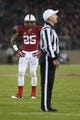 Nov 30, 2013; Stanford, CA, USA; Stanford Cardinal cornerback Alex Carter (25) watches as the referee announces the review decision for a personal foul against Carter during the third quarter against the Notre Dame Fighting Irish at Stanford Stadium. The Stanford Cardinal defeated the Notre Dame Fighting Irish 27-20. Mandatory Credit: Kelley L Cox-USA TODAY Sports
