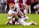 Nov 30, 2013; Columbia, SC, USA; Clemson Tigers quarterback Tajh Boyd (10) is sacked by South Carolina Gamecocks linebacker Kaiwan Lewis (8) in the second quarter at Williams-Brice Stadium. Mandatory Credit: Jeff Blake-USA TODAY Sports
