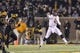 Nov 30, 2013; Columbia, MO, USA; Texas A&M Aggies quarterback Johnny Manziel (2) throws a pass against the Missouri Tigers during the second half at Faurot Field. Missouri defeated Texas A&M 28-21. Mandatory Credit: Peter G. Aiken-USA TODAY Sports