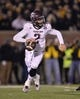 Nov 30, 2013; Columbia, MO, USA; Texas A&M Aggies quarterback Johnny Manziel (2) rolls to the outside against the Missouri Tigers during the second half at Faurot Field. Missouri defeated Texas A&M 28-21. Mandatory Credit: Peter G. Aiken-USA TODAY Sports