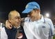 Nov 30, 2013; Los Angeles, CA, USA; UCLA Bruins coach Jim Mora (right) celebrates with athletic director Dan Guerrero at the end of the game against the Southern California Trojans at Los Angeles Memorial Coliseum. Mandatory Credit: Kirby Lee-USA TODAY Sports