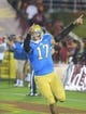 Nov 30, 2013; Los Angeles, CA, USA; UCLA Bruins quarterback Brett Hundley (17) celebrates after a touchdown in the fourth quarter against the Southern California Trojans at Los Angeles Memorial Coliseum. Mandatory Credit: Kirby Lee-USA TODAY Sports