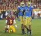 Nov 30, 2013; Los Angeles, CA, USA; UCLA Bruins linebacker Anthony Barr (11) celebrates with defensive end Ellis McCarthy (90) after sacking Southern California Trojans quarterback Cody Kessler (6) in the fourth quarter at Los Angeles Memorial Coliseum. Mandatory Credit: Kirby Lee-USA TODAY Sports